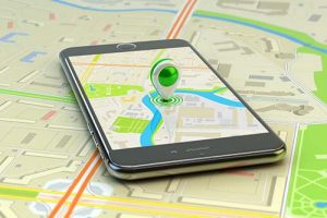 Smartphone with city map application and marker pin pointer on phone screen